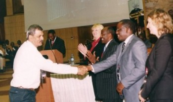 ART-TZ Executive Director, Nachiket Potnis receiving the LRTC award from REA and World Bank officials in Arusha, Tanzania