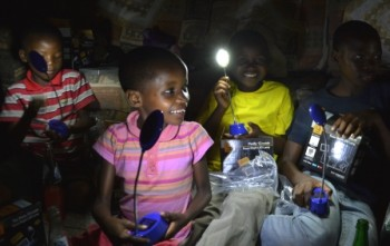 Orphans receiving solar lights donated by Kim and Jason Pineau
