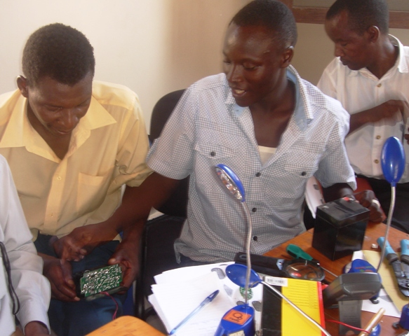 ARTI-TZ Technicians, Kennedy Mremi and Godson Mghamba, repair receiving Barefoot technical certification