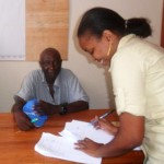 "Jacqueline Michael, LRTC Project Officer, signing the contract with Abel Shop under the ""Mauli Kauli"" Project"