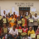 Participants of Kiromo Village hold their certificates after completing the training