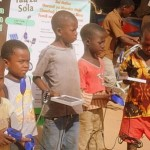 Children from Ndelema Market testing the Fire Fly 12 Mobile