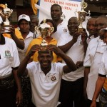 ARTI's Godson Mghamba holds the Public Service Week trophy high after winning best pavilion 2011