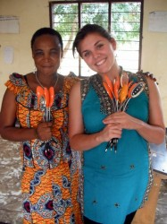 Carla Acosta, a Canadian intern with ARTI, poses with a teacher and their bouquets of solar lamps