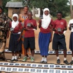 Teachers and Students at Pinga Primary School posing with their new solar lights