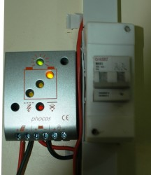 charge controller (left) regulating the solar energy to the battteries