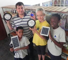 IST students learning about solar with Dennis from ARTI