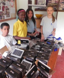 IST students unpacking the solar lights