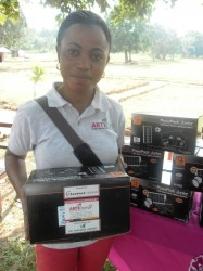 Esther John from ARTI Energy displays the solar lights that were distributed by TRANSMAR.  Esther also lead the technical team responsible for training of teachers and students as well as quality control