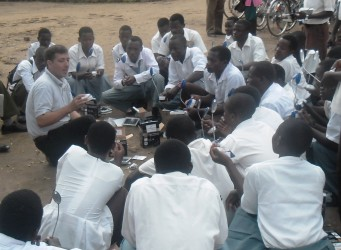 Dennis Tessier from ARTI Energy instructs students on how to use their solar lanterns