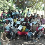 Training participants with their certificates following the char powder training.