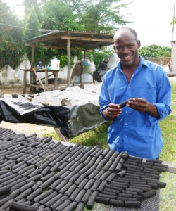 Yasin Thabiti with non-wood charcoal briquettes made from dry biomass